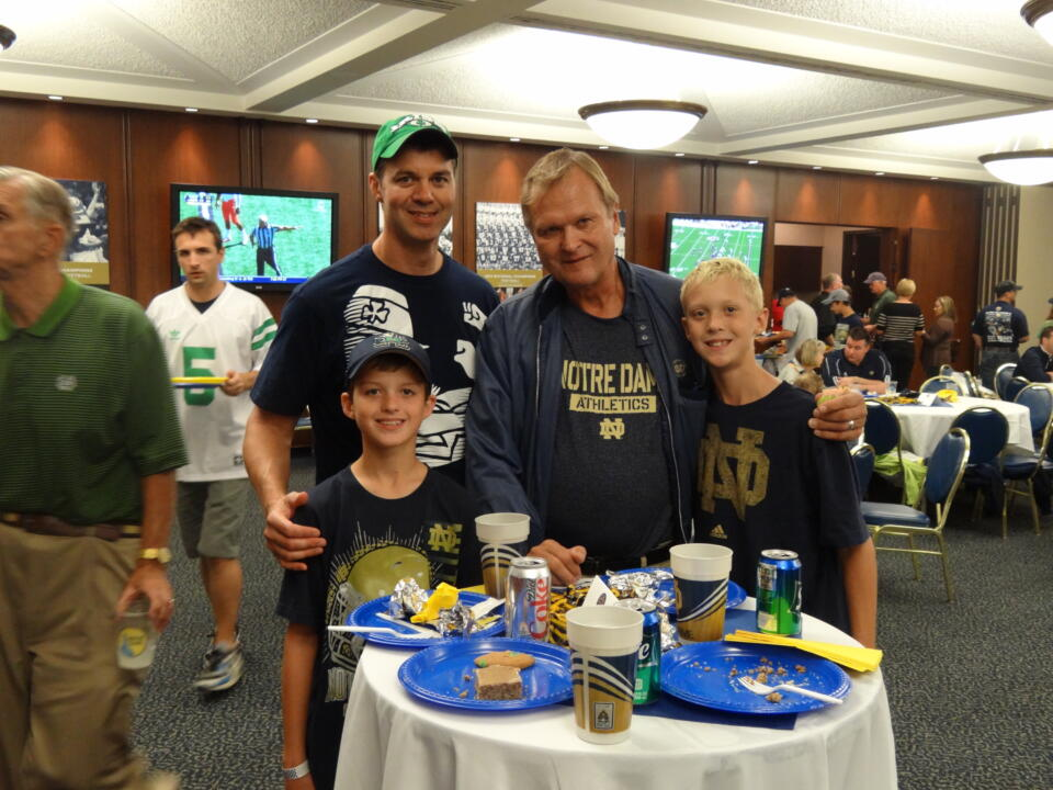 A Monogram family enjoys Saturday's pre-game reception in the Monogram Room.