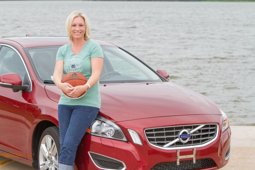 Lisa Kelly poses with her brand new Volvo - the top prize in the Biggest Fan of the BIG EAST search