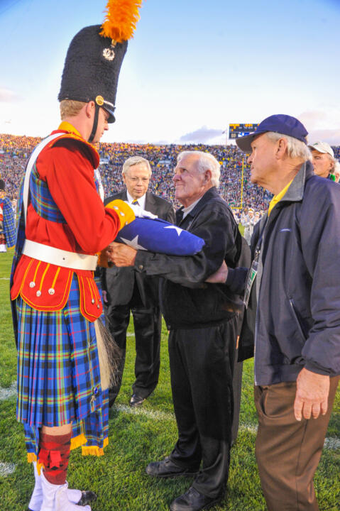 Legendary Notre Dame football head coach Ara Parseghian presented the flag prior to the Michigan game to commemorate the 125th anniversary of Notre Dame football (courtesy of Mike & Susan Bennett).