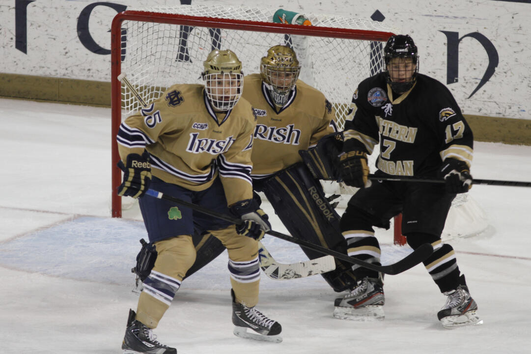 Notre Dame defenseman (#25) Kevin Lind and goaltender Steven Summerhays stop a Western Michigan scoring bid.  The Irish limited the Broncos to 14 shots in a 4-0 win.