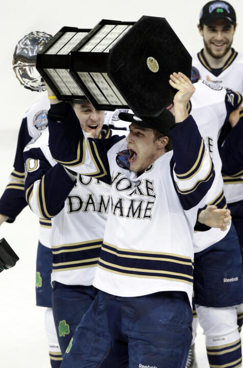 Notre Dame captain Anders Lee with the final CCHA Mason Cup trophy on March 24th.  On Monday, July 1, the Irish become members of Hockey East