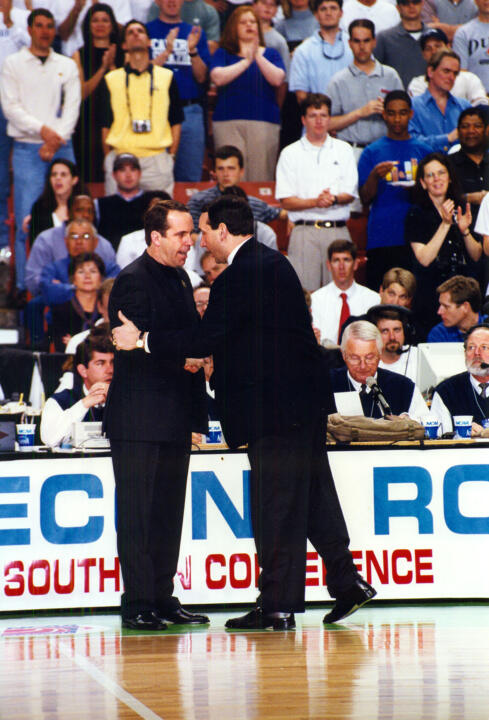 Notre Dame head coach Mike Brey shakes hands with Duke head coach Mike Krzyzewski before their teams' NCAA Tournament second-round game in 2002 in Greenville, S.C.