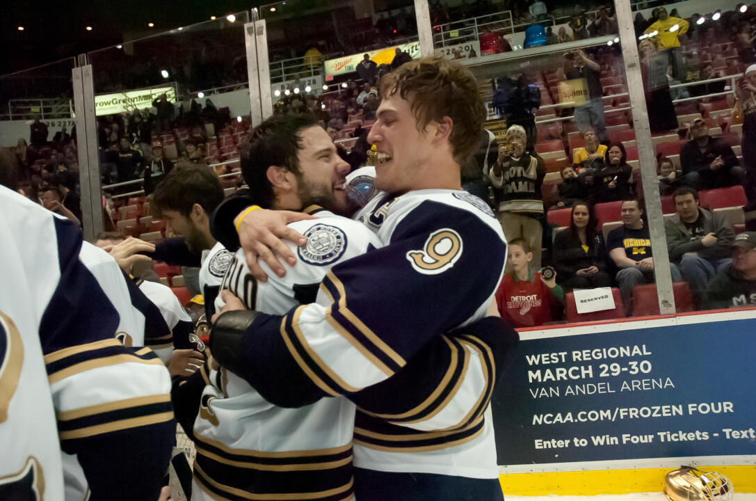 Notre Dame's newest captain - Jeff Costello (left) - celebrates the 2013 CCHA championship with former captain Anders Lee (right).