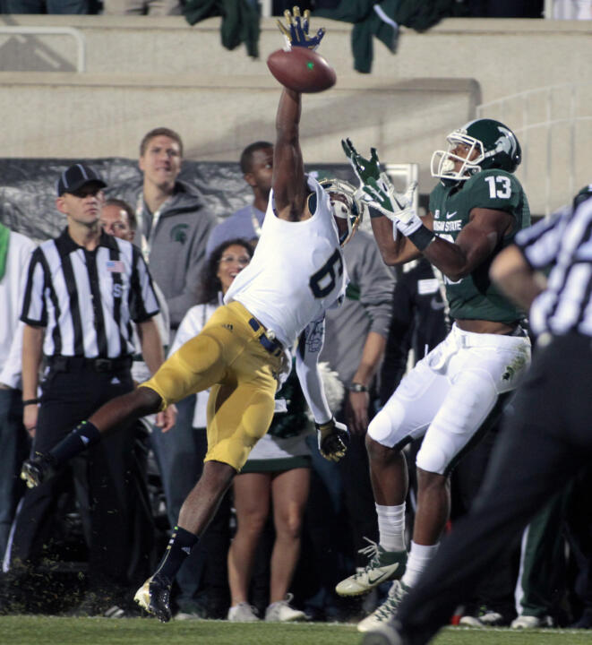 KeiVarae Russell knocks away a pass intended for Michigan State's Bennie Fowler in last year's game.
