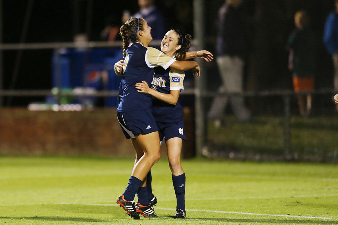Senior midfielder/tri-captain Elizabeth Tucker (right) celebrates with junior forward Lauren Bohaboy (left) after the first of Tucker's two goals in Thursday's 3-2 double-overtime loss at #1 Virginia.