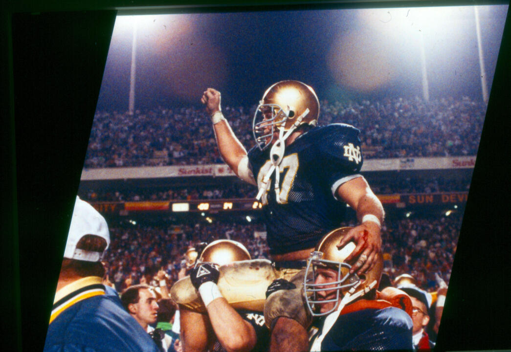 Led by All-America linebacker and team co-captain Ned Bolcar, Notre Dame planted its flag atop the college football mountain for the 11th time in 1988, clinching the national championship and a perfect 12-0 season with a 34-21 win over West Virginia at the Sunkist Fiesta Bowl in Tempe, Ariz.