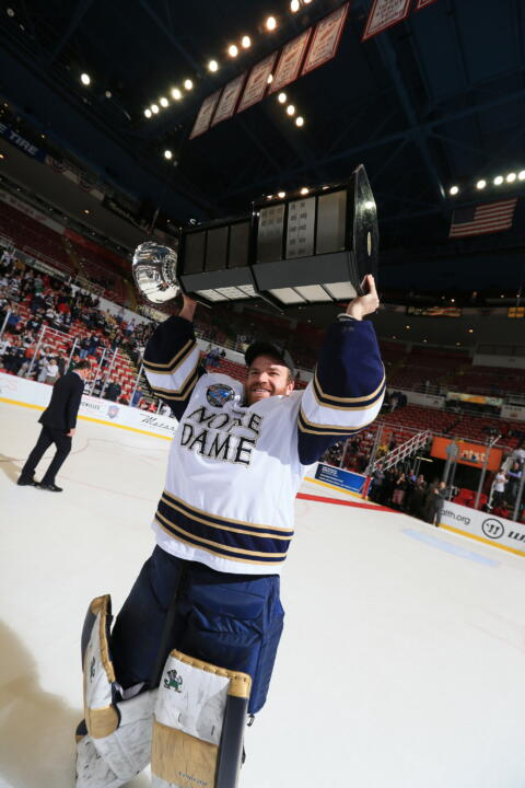 Senior goaltender Joe Rogers, shown with the 2012 Mason Cup, gives his perspective on Notre Dame's travels to new places in Hockey East this season.