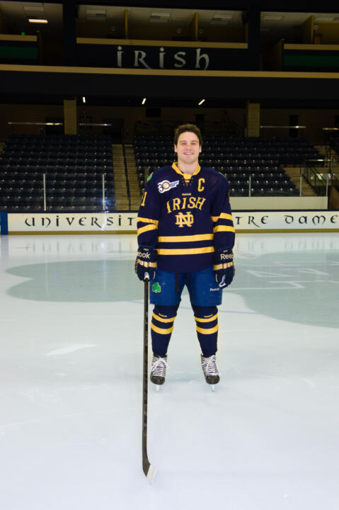 Senior captain Jeff Costello models the jersey that Notre Dame will wear on Jan. 4, 2014 at Frozen Fenway.