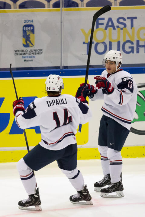 Thomas DiPauli celebrates a Team USA goal with Vince Hinostroza.
