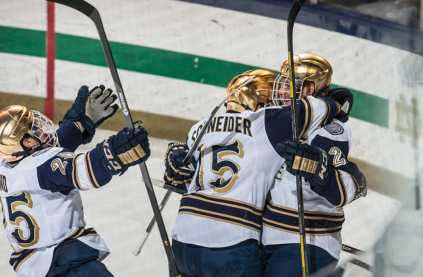 Peter Schneider (left) and Steven Fogarty (right) celebrate an Irish goal against Lake Superior State.