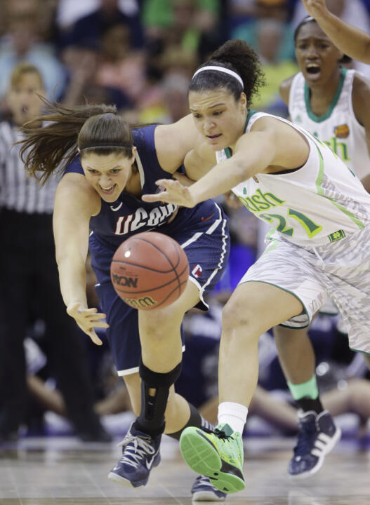 Kayla McBride battles for a loose ball with Connecticut center Stefanie Dolson in last year's Final Four.