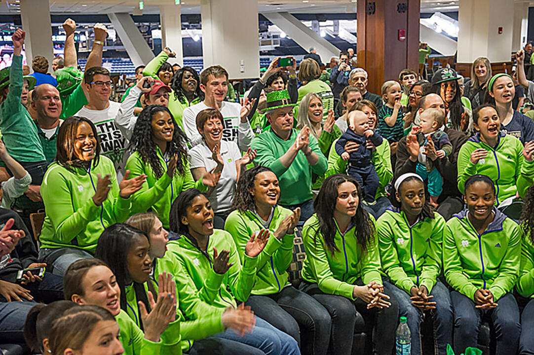 Notre Dame head coach Muffet McGraw (center, white shirt) and the Fighting Irish celebrate their selection as a No. 1 seed in the 2014 NCAA Championship. Notre Dame will open tournament play at 1:30 p.m. (ET) Saturday against Robert Morris in Toledo, Ohio.