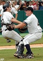 Notre Dame catcher Paul O'Toole, left, and relief pitcher J. P. Gagne celebrate the final out of their 3-1 win over Florida State in the NCAA Super Regional, Monday, June 10, 2002, in Tallahassee, Fla. With the win, Notre Dame advanced to the College World Series for the first time in 45 years. (AP Photo/Phil Coale)