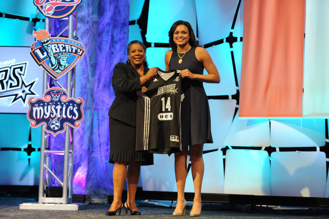 Senior guard/tri-captain Kayla McBride (shown here with WNBA President Laurel Richie) was selected by the San Antonio Stars with the No. 3 overall pick in the first round of the 2014 WNBA Draft on Monday night in Uncasville, Conn.