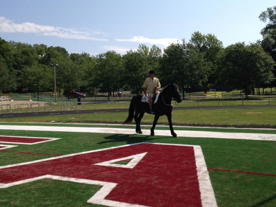 Head coach Brian Kelly rode one of Culver Academies' famed black horses onto the practice field on Friday.