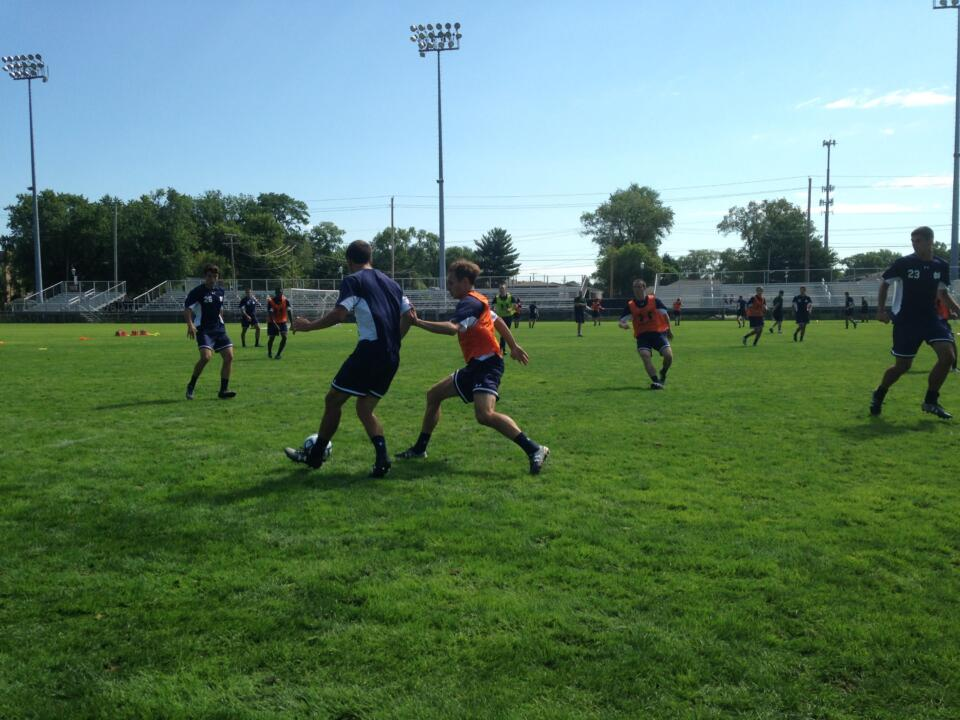 Senior left back Max Lachowecki (right) defending during Wednesday's first practice.