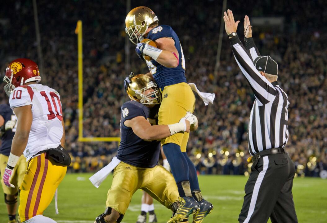 Nick Martin celebrates a Notre Dame touchdown with tight end Troy Niklas.