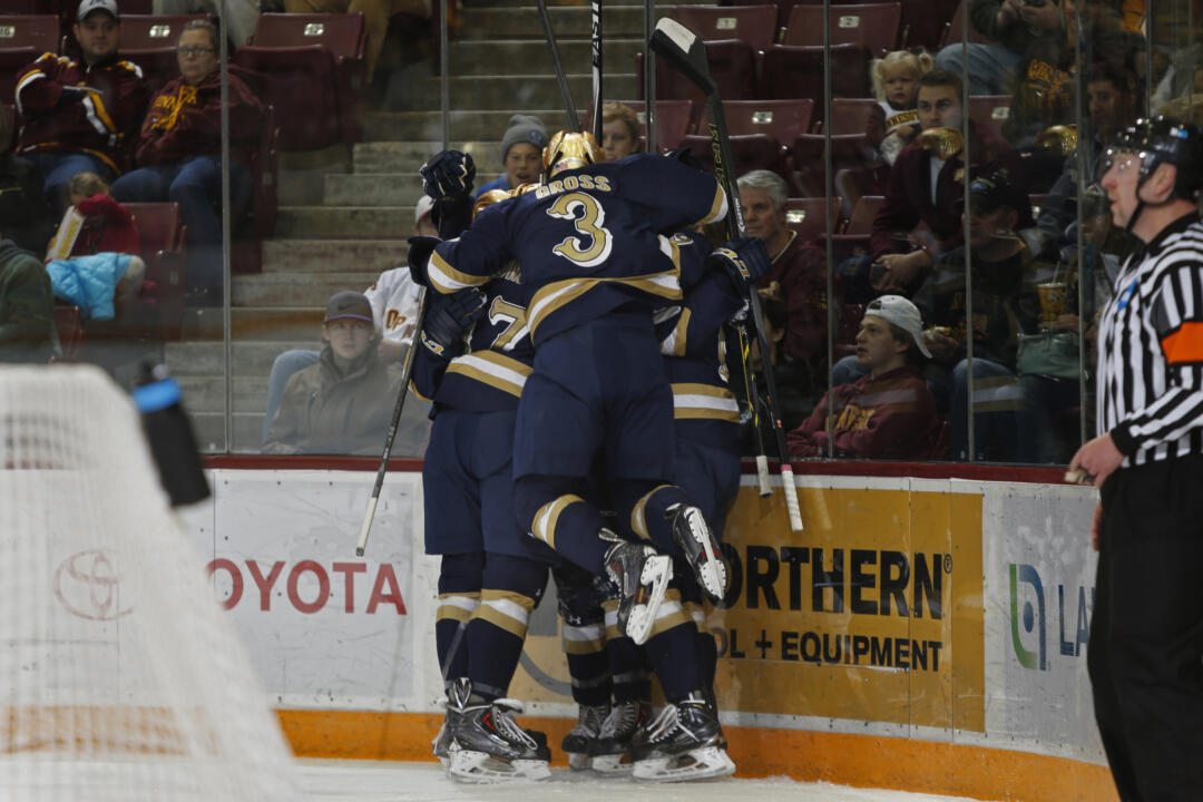 The Irish celebrate Austin Wuthrich's second-period goal versus Minnesota.