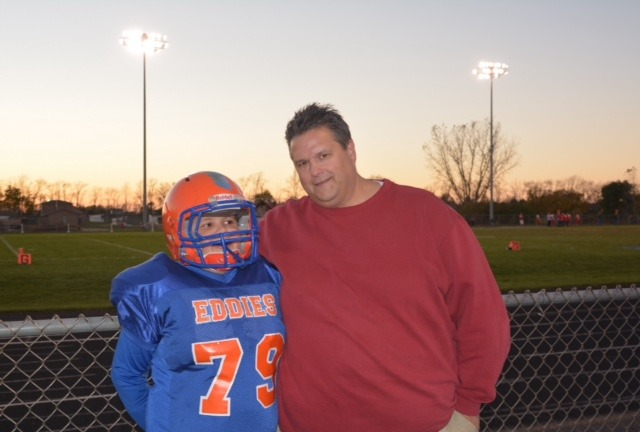 Jake, who is pictured with his father John, proudly wears his No. 79 uniform.  It is the same number worn by his friend, Steve Elmer.