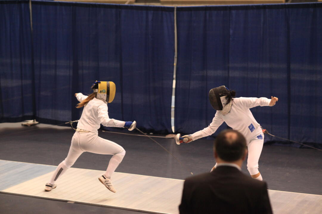 Nicole Ameli (left) won the first-ever ACC women's epee title Sunday, beating teammate and co-captain Ashley Severson.