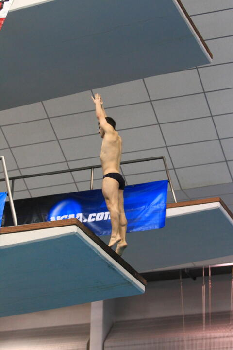 Joe Coumos earned the highest score for the Irish Thursday in the men's one-meter event.