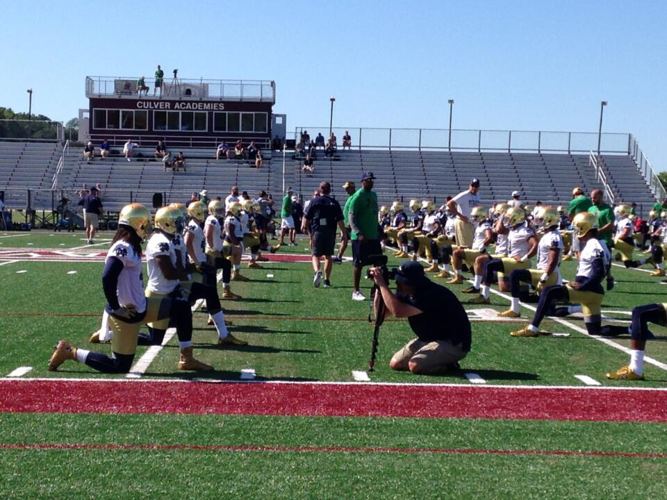 Notre Dame's seniors lead their peers in stretching before the first preseason practice at Culver Academies.