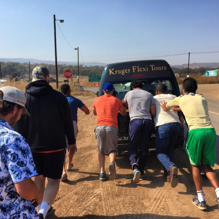 Corey Robinson and friends push a bus that broke down on the way to the safari.