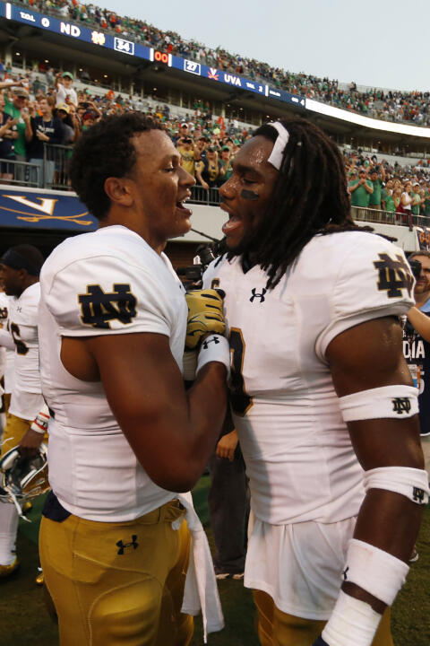 DeShone Kizer (14) celebrates with Jaylon Smith (9) after their game against the Virginia Cavaliers