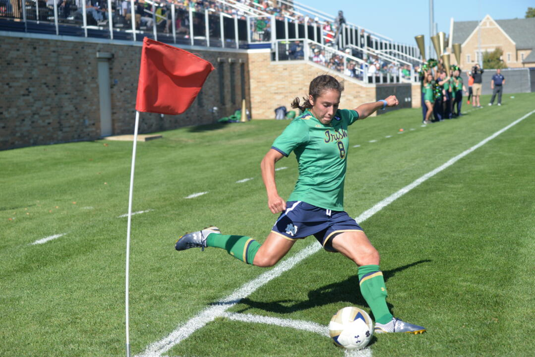 Sophomore midfielder Sabrina Flores rears back to launch a corner kick service during Notre Dame's 2-0 victory over Boston College on Sunday.