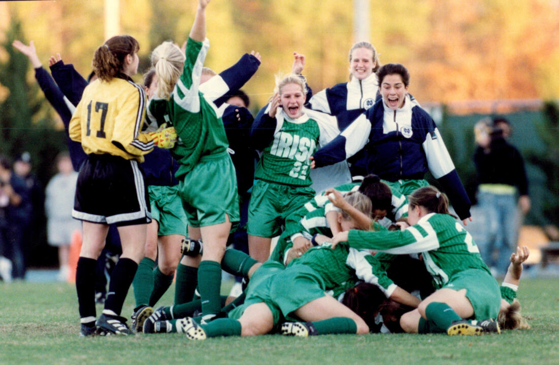 Cindy Dawn is mobbed by teammates after scoring the game-winning goal (1-0) in the national championship game against Portland in the three-overtime thriller.