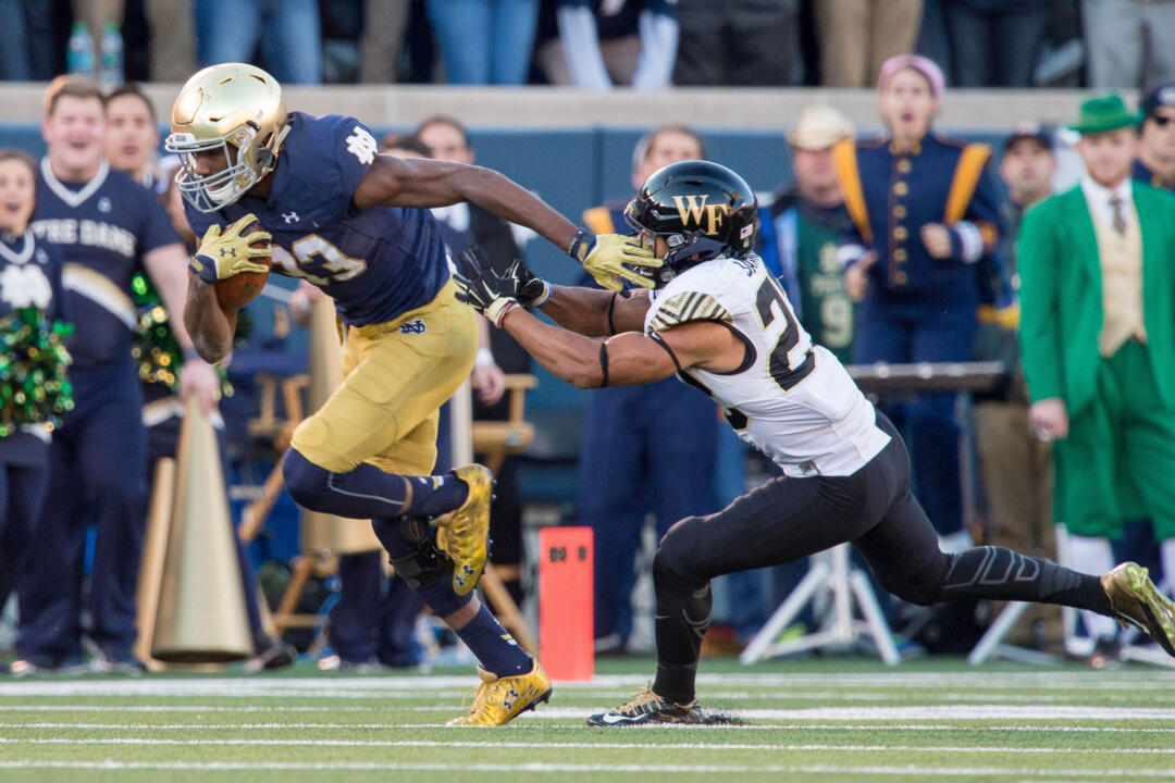 Josh Adams established a Notre Dame record with a 98-yard touchdown run in the second quarter of a 28-7 win over Wake Forest