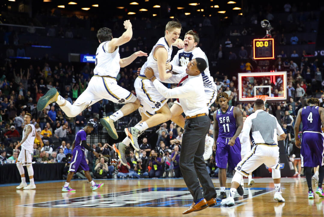 Mar 20, 2016; Brooklyn, NY, USA; Notre Dame Fighting Irish guard Rex Pflueger (middle) celebrates with his teammates as time expires after tipping in the winning basket against the Stephen F. Austin Lumberjacks in the second round of the 2016 NCAA Tournament at Barclays Center. Credit: Anthony Gruppuso-USA TODAY Sports