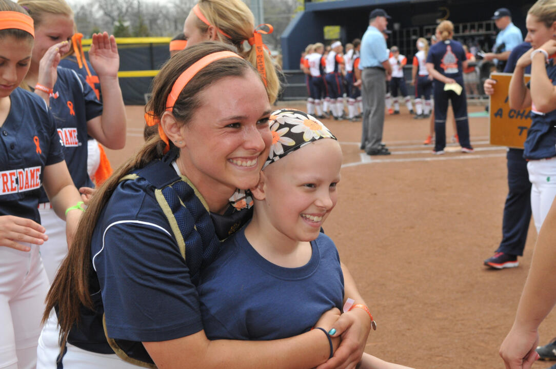 Senior catcher Casey Africano and softball Fighting Irish Fight for Life teammate Hannah at the 2015 Strikeout Cancer series