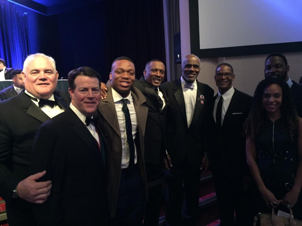 At the Heisman Dinner Gala Monday in New York--(left to right) Mike Brennan, Monogram Club president Kevin O'Connor, Romeo Okwara, Tim Brown, Justice Alan Page, Byron Spruell and Justin and Lauran Tuck