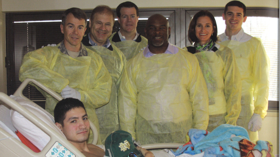 Bryan Fenton (left) with members of the Monogram Club board of directors and staff at the Walter Reed National Military Medical Center in 2011.