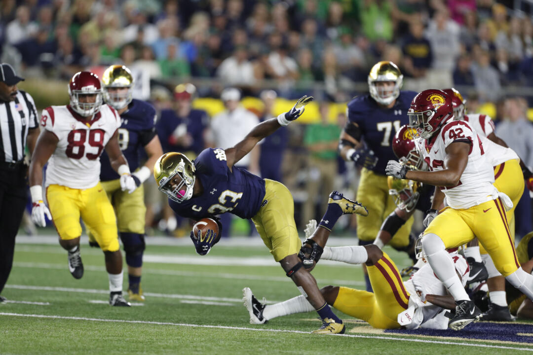 Oct 21, 2017; South Bend, IN, USA; Notre Dame Fighting Irish running back Josh Adams (33) runs with the ball against the Southern California Trojans at Notre Dame Stadium. Mandatory Credit: Brian Spurlock-USA TODAY Sports